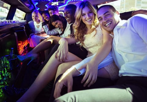people having a good time inside a car